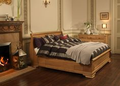 An original French sleigh bed design, the luxurious Parisienne sleigh bed is available in a number of solid wood finishes, including sustainable solid oak. Wooden Sleigh Bed, Sleigh Beds, Solid Oak Beds, Bed Company, Natural Wood Finish, Wood Beds, Real Wood, Bed Design, Handmade Wooden
