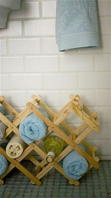 Love the wine rack towel idea - 14 Products That Will Help You Destroy Clutter - 101 Days of Organization