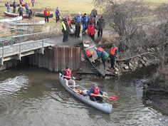 """Portage in Morton Grove Illinois. New Year's Day """"Happy Canoe Year"""" event on the North Branch of the Chicago River."""