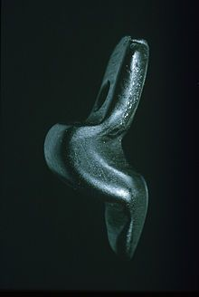 'The Venus of Monruz' or 'The Venus of Neuchâtel'  --  Magdalenian Era  --  Circa 11,000-9000 BCE  --  Medium: Jet  --  Height: 18 cm  --  Excavated in 1991 at the construction of the N5 highway, at Monruz in the municipality of Neuchâtel, Switzerland.