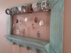 Upcycled pallet rustic jewelry holder/organizer in distressed turquoise, one of a kind. For sale at Hanky Planky on Etsy