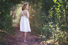 This stunning lace flower girl dress is made from soft stretch cotton. Delicate lace cross back straps make this dress feel so rustic and