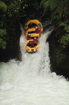 White water rafting down 7 meter falls on the Kaituna River with Kaitiaki Adventures. Near Rotorua, New Zealand.