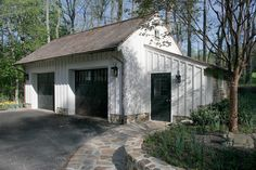 garage doors, dark with blending bronze gutters and shutters....fresh chalky white...timeless!                                                                                                                                                                                 More