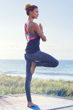 Strike a confident pose in a bright pink sports bra, tank top, and tights in fast-drying, functional fabric. | H&M Sport