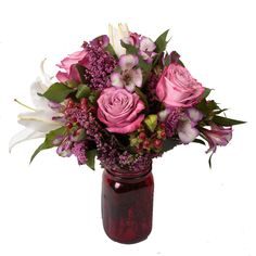 """#1 in my book! She says she doesn't want anything fancy- but you know she secretly wants you to pull out all the stops! This bouquet says """"You Are Simply Number ONE!"""" Red Vintage Jar filled with lavendar roses, Spring accent flowers and a whole lot of Love!  Soderberg's Floral and Gift"""