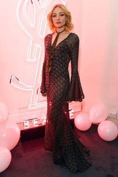 Model, Clara Paget also attended, wearing a patterned bell-sleeve maxi dress, matching neck tie and 60s waves.