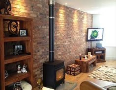 Brick Slips made by Real Brick Ltd. Bringing the beauty of brick to your home and business. UK Brick Slip provider based in Pocklington call: 01759 307979 House Styles, Brick Wall Living Room, Exposed Brick Walls, Brick Tile Wall, Brick Fireplace, Living Room With Fireplace, Inglenook Fireplace, Barn Kitchen, Brick Slips Kitchen