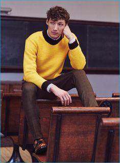 Westley Moore wears yellow sweater Gucci, striped shirt Dior Homme, check trousers Givenchy, and brown leather dress shoes Prada.