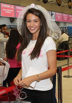 I'm getting married in... next month! Michelle Keegan arrives at Manchester airport for her hen party trip to Dubai