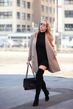 black dress with coat and thigh high boots
