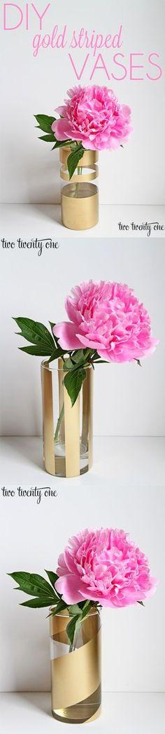 DIY gold striped vases– dollar store vases + tape + spray paint!