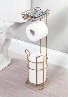 A toilet paper dispenser with a storage shelf for a) never getting stranded without TP thanks to its handy compartment for extra rolls and b) streamlining bathroom essentials to one spot. 42 Things That'll Give You No Choice But To Stay Organized Boho Bathroom, Bathroom Interior, Bathroom Storage, Modern Bathroom, Small Bathroom, Rental Bathroom, Bathroom Canvas, Brass Bathroom, Industrial Bathroom