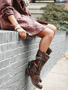 Distressed leather boots.