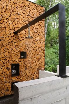 Contemporary Patio with Outdoor shower, Fence, Wood wall, Kohler Contemporary Round Rain Shower Head, Rain shower
