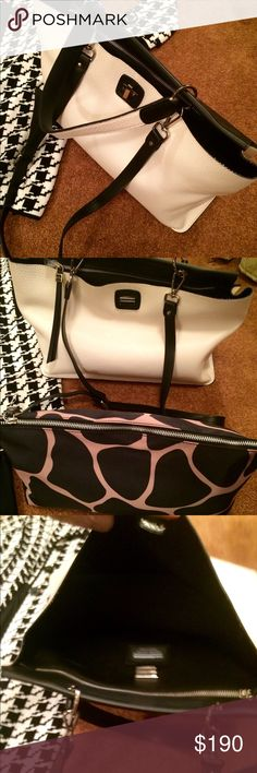 Gianni Chiarini Italian Leather Bag NWOT This beautiful black and white bag is absolutely incredible. Made in Italy. Genuine leather. Two tone black on one side and white on the other. Removable nylon inner bag in a black and white giraffe print. Long shoulder strap also included. Ask for measurements and extra pics. ❤️️❤️️❤️️ Gianni Chiarini Bags Totes