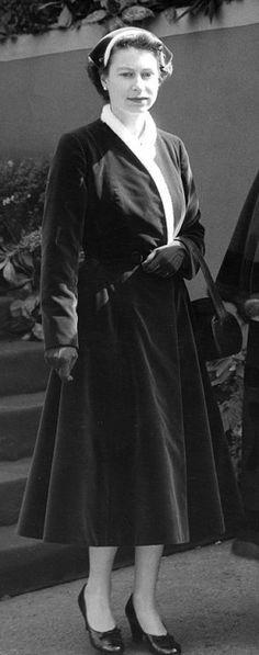 The Queen.  Looks like her dress is velvet.  Pretty.