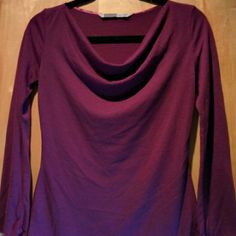 Athleta drape-neck tunic Athleta tissue-thin wool-blend  ~shapely~ tunic top.  Super-sexy. Lovely Raspberry color  Runs quite roomy.  Fits small to medium, slim in the arms. Athleta Tops Tunics