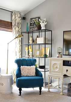 Loving this peacock colored chair and entire Family Room makeover decor @Cheryl Sousan | Tidymom.net