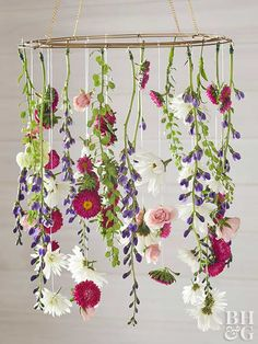 Make your Easter home decor extra special this year with a fresh flower chandelier. #bhg #easter #easterdecor