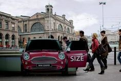 Cool advertising placed at the train station in Zurich gives the impression that people are going in and coming out of the MINI Cooper.