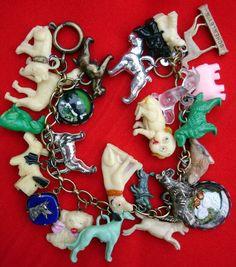 Vintage dog charms (plastic, celluloid, metal) from PaulaMontgomery (Etsy) #handmadebraceletsvintage