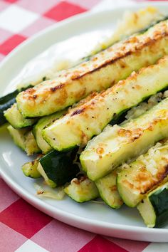 Garlic Lemon and Parmesan Oven Roasted Zucchini - These are a summer side that you must try. You might even like them so much you'll forget about the main dish.