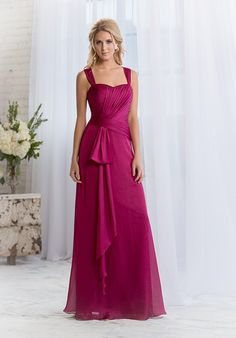 Amber Satin Chiffon gown with asymmetrical waistline, ruched bodice, and chiffon sash at waist. Also available in tea or knee length.