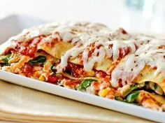 Panela Vegetable Lasagna Ingredients:      1 package (10 oz.) Cacique® Panela, shredded     2 (14 oz.) cans low sodium chicken broth     1 (9 oz.) package oven-ready lasagna noodles     2 medium zucchini, thinly sliced lengthwise     2 (26 oz.) jars marinara sauce     1 (15 oz.) jar roasted red (or red and yellow) peppers, rinsed and chopped     1 (6 oz.) package fresh spinach     1 (7 oz.) can corn, Mexican style, drained     Salt and pepper to taste
