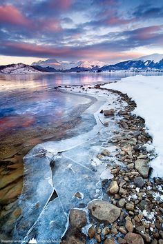 Ushuaia, Argentina I like how the snow and ice is divided by the rocks. I also like how the colors of the sky are reflected on the ice. Ushuaia, Places To Travel, Places To See, Places Around The World, Around The Worlds, Belle Photo, Dream Vacations, Beautiful Landscapes, Beautiful World