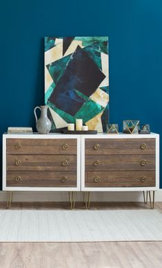 Double dresser as console | Joss & Main  A gorgeous reasonable priced console can be hard to come by, a clever alternative is to use a double dresser. This stunning one found on Joss & Main is perfectly set off against a dark teal wall, finished with a funky painting, accessories and voila!