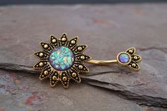 14kt gold belly button rings, purple opal sunburst belly button rings. Purple opal faux glitter belly ring. This glittery opal has flecks of pink, yellow and greens and is set in a tribal shaped sun,