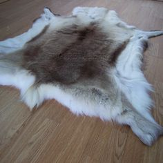Reindeer Skin Rugs Originating from areas around Sweden, Finland and Norway, each skin is unique in markings and shade. They're perfect for use as a rug, wall hanging or over a settee or chair. Our Reindeer skins Loft Furniture, Furniture Decor, Carpet Flooring, Rugs On Carpet, Beach Shack, Scandi Style, Scandinavian Design, Natural Skin, Brown And Grey