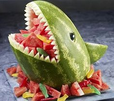 Shark Fruit Salad - Birthday Cake for a healthy foods only kinder. Maybe get a fish shaped cookie cutter? Different coloured melon etc?