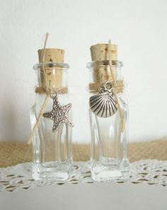 Great favor idea!    Sand Bottle Wedding Favor for Your Beach Wedding -- Your Choice of Charm -- Set of 100. $115.00, via Etsy.