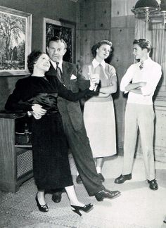 George Burns and Gracie Allen dance while children Sandy and Ronnie stand by.
