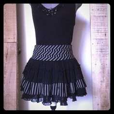 "Black & Gray Ruffle Mini Skirt Forever 21 Black & Gray Mixed Media Ruffle Mini Skirt. Size XS measures: 28"" around top, 14"" long. Outer layer of chiffon ruffle and contrasting striped material is 109% cotton. Skirt is fully lined with side zip closure. In great condition. 309/250/040216 Forever 21 Skirts Mini"