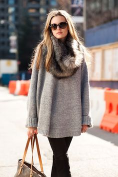 winter: black tights, grey sweater, chunky scarf.