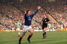 Brian Laudrup celebrates after netting the winner in the 2-1 Scottish Cup semi-final win over Celtic in 1997