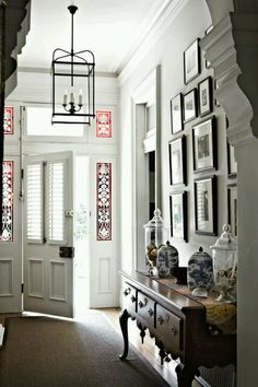 Entryway and hall inspiration. The ruby leadlight windows are an original feature, while the carriage lantern is from Magins Classical Lighting and the hall table is English Oak from Cotswold Furniture. Style At Home, Houses Architecture, Interior Architecture, Leadlight Windows, Victorian Hallway, Br House, Town House, Interior And Exterior, Interior Design