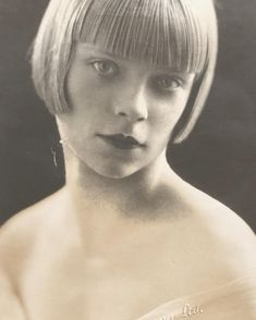 1920s postcard of a young woman with a sharp cut bob, cupid's bow lips and haunting eyes - taken by Navana Ltd, 518 Oxford Street, London