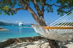 Relax with a view. Enjoy some shade in Labadee and unwind in one of the island's hammocks.