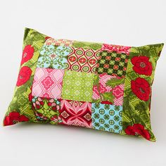 Three of a Kind  Judy used a design wall to choose her prints so that she could move them around until she was pleased with the combination. If you don't have a design wall, use a piece of cotton flannel on a vertical surface   Click on for instructions to make this pillow.