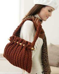 Free crochet bag pattern. Would also make a fun summer bag in a bright color with cotton yarn.