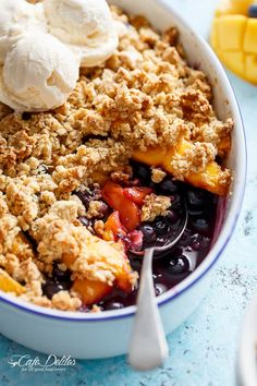 A classic and Easy Mango Blueberry Crumble with the crispy, buttery topping that's lighter in calories and BIG on flavour!