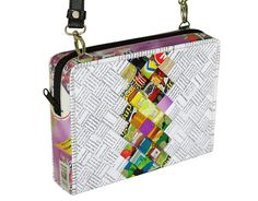 This medium size zip crossbody bag is made using candy wrappers at the center part of the bag, and office document paper at the sides of it. Both materials are folded into strips and woven tightly. It has a zipper closure and adjustable length strap made of vinyl.  Features: YKK top closure zipper. One inner zip pocket. Polyester fabric for lining.  Dimensions in inches: Height 6.8, Length 9.2, Thickness 2  Dimensions in centimeters: Height 17.5 cm, Length 23.2 cm, Thickness 5 cm  Maximum…