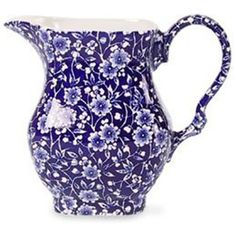 This 9 oz. chintzware creamer dates to the mid 1900's. I love chintzware. If you are lucky enough to come across a chintzware piece with a blue background and white floral print, it will look amazing mixed in with other blue on white pieces. Chintz patterns were inspired by the dresses worn by decorating girls in the Staffordshire pottery firms.