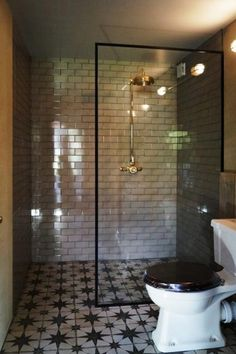 Glass shower screen with a black frame around from Creative Glass Studio installed in London. Idea for small downstairs bathroom Loft Bathroom, Downstairs Bathroom, Family Bathroom, Modern Bathroom, Small Bathroom, Bathroom Ideas, Restroom Ideas, Bathroom Hacks, Bathroom Grey