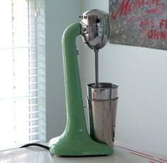Vintage Hamilton Beach jadeite mixer  It was scary using one of this, it made a terrible sound if you hit the metal with the blades......