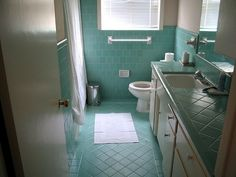 retro cool bathroom tile. wouldn't put it in but wouldn't rip it out. #turquoise #aqua